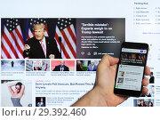 Купить «Adygea, Russia - January 5, 2018: the news feed of the popular Yahoo website of the Yahoo search engine on the screen of the Chinese smartphone Xiaomi in the male hand», фото № 29392460, снято 5 января 2018 г. (c) Андрей С / Фотобанк Лори