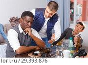 Купить «Offended man during quarrel with friends», фото № 29393876, снято 23 февраля 2018 г. (c) Яков Филимонов / Фотобанк Лори