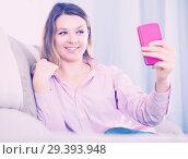 Купить «Female posing with her phone and taking photos», фото № 29393948, снято 13 марта 2017 г. (c) Яков Филимонов / Фотобанк Лори