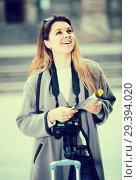 Купить «traveling girl searching for the direction using a booklet in the town», фото № 29394020, снято 27 марта 2017 г. (c) Яков Филимонов / Фотобанк Лори