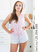 Купить «Young woman in white shorts at room», фото № 29394088, снято 24 июня 2017 г. (c) Яков Филимонов / Фотобанк Лори