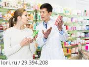 Купить «Joyful client asking pharmacist about medicines», фото № 29394208, снято 26 марта 2018 г. (c) Яков Филимонов / Фотобанк Лори