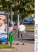 Купить «Молодой мужчина на протезах», эксклюзивное фото № 29394732, снято 21 августа 2015 г. (c) Алёшина Оксана / Фотобанк Лори