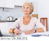 Купить «Woman put in order documents», фото № 29396572, снято 11 июля 2018 г. (c) Яков Филимонов / Фотобанк Лори