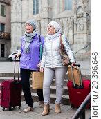 Купить «Elderly women strolling with luggage along city street», фото № 29396648, снято 26 ноября 2017 г. (c) Яков Филимонов / Фотобанк Лори