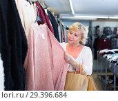 Купить «woman buyer choosing color cardigan», фото № 29396684, снято 20 декабря 2017 г. (c) Яков Филимонов / Фотобанк Лори