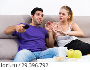 Купить «Woman trying to take away TV remote from boyfriend», фото № 29396792, снято 18 июня 2019 г. (c) Яков Филимонов / Фотобанк Лори
