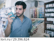 Customer man looking instruction on paint. Стоковое фото, фотограф Яков Филимонов / Фотобанк Лори