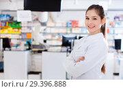 Купить «Portrait of woman pharmacist who is standing on her work place i», фото № 29396888, снято 28 февраля 2018 г. (c) Яков Филимонов / Фотобанк Лори