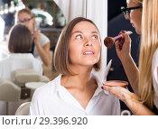 Купить «female makeup artist applying cosmetics for woman», фото № 29396920, снято 14 декабря 2019 г. (c) Яков Филимонов / Фотобанк Лори