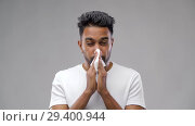 Купить «indian man with paper napkin blowing nose», видеоролик № 29400944, снято 1 ноября 2018 г. (c) Syda Productions / Фотобанк Лори