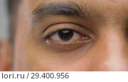 Купить «close up of south asian male eye with brown iris», видеоролик № 29400956, снято 1 ноября 2018 г. (c) Syda Productions / Фотобанк Лори