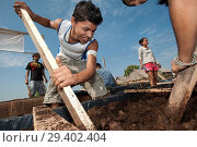 Купить «Children of Belen's working on 'balsita' garden, it's a project of Restinga association for to build familiar floating garden in the aim to contrast the...», фото № 29402404, снято 13 августа 2011 г. (c) age Fotostock / Фотобанк Лори