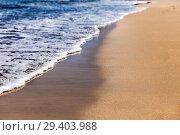 Купить «Пенистый прибой на песочном тропическом пляже», фото № 29403988, снято 24 сентября 2015 г. (c) Евгений Ткачёв / Фотобанк Лори