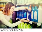 Купить «Girl customer looking for effective deodorant in supermarket», фото № 29405736, снято 23 ноября 2016 г. (c) Яков Филимонов / Фотобанк Лори