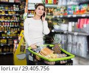Купить «Customer telephoning to consult», фото № 29405756, снято 23 ноября 2016 г. (c) Яков Филимонов / Фотобанк Лори