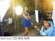 Купить «Professional photo shooting outdoors. Attractive female model po», фото № 29405840, снято 5 октября 2018 г. (c) Яков Филимонов / Фотобанк Лори