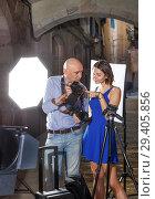 Купить «Photographer showing photos on camera to model girl», фото № 29405856, снято 5 октября 2018 г. (c) Яков Филимонов / Фотобанк Лори