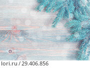 Купить «New Year and Christmas background. Blue fir tree branches with snowflakes on the light wooden background», фото № 29406856, снято 8 мая 2017 г. (c) Зезелина Марина / Фотобанк Лори