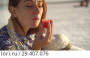 Купить «happy smiling girl enjoying the sunset, eating watermelon, sit on salt, close-up», видеоролик № 29407076, снято 10 ноября 2018 г. (c) Ирина Мойсеева / Фотобанк Лори