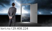 Купить «Businessman standing by open door with surreal dark sea glow and sky», фото № 29408224, снято 19 января 2019 г. (c) Wavebreak Media / Фотобанк Лори
