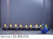 Купить «Defocused lights of Jewish holiday Hanukkah and spinning top», фото № 29408616, снято 10 ноября 2018 г. (c) Константин Сенявский / Фотобанк Лори