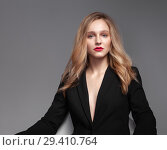 Купить «High fashion portrait of young elegant woman in black suit.», фото № 29410764, снято 28 октября 2018 г. (c) Restyler Viacheslav / Фотобанк Лори