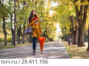 Young Woman walks in autumn park. Стоковое фото, фотограф Типляшина Евгения / Фотобанк Лори