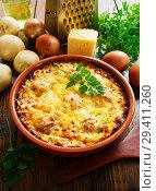 Купить «Картофельная запеканка с фрикадельками под сыром», фото № 29411260, снято 29 сентября 2018 г. (c) Надежда Мишкова / Фотобанк Лори