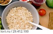 Купить «healthy breakfast of oatmeal and other food», видеоролик № 29412100, снято 2 ноября 2018 г. (c) Syda Productions / Фотобанк Лори
