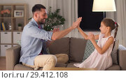 Купить «father and daughter playing clapping game at home», видеоролик № 29412108, снято 6 ноября 2018 г. (c) Syda Productions / Фотобанк Лори