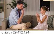 Купить «father and daughter playing clapping game at home», видеоролик № 29412124, снято 6 ноября 2018 г. (c) Syda Productions / Фотобанк Лори