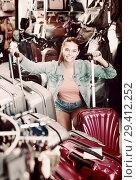 Купить «positive teenager girl choosing new large plastic luggage bag», фото № 29412252, снято 15 сентября 2016 г. (c) Яков Филимонов / Фотобанк Лори