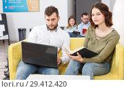 Young people with laptop and book. Стоковое фото, фотограф Яков Филимонов / Фотобанк Лори
