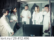 Купить «Five adults solving conundrums together in quest room in view as abandoned lab», фото № 29412496, снято 6 июля 2017 г. (c) Яков Филимонов / Фотобанк Лори