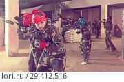 Купить «gamers in red masks are ready for attack», фото № 29412516, снято 10 июля 2017 г. (c) Яков Филимонов / Фотобанк Лори