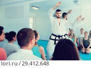 Купить «Male trainer teaches movements in karate», фото № 29412648, снято 8 апреля 2017 г. (c) Яков Филимонов / Фотобанк Лори