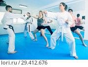 Купить «Adults trying new martial moves at karate class», фото № 29412676, снято 8 апреля 2017 г. (c) Яков Филимонов / Фотобанк Лори