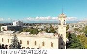 Купить «Gori city in Georgia Stalin's homeland 4K drone flight», видеоролик № 29412872, снято 6 ноября 2018 г. (c) Aleksejs Bergmanis / Фотобанк Лори