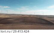 Купить «Wind power stations in the desert white power cells», видеоролик № 29413424, снято 6 ноября 2018 г. (c) Aleksejs Bergmanis / Фотобанк Лори