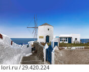Купить «View of the city of Oia. Santorini Island in Greece», фото № 29420224, снято 8 июня 2017 г. (c) Наталья Волкова / Фотобанк Лори
