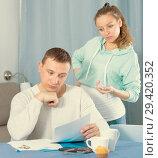 Купить «Husband and pregnant wife arguing at home», фото № 29420352, снято 18 марта 2017 г. (c) Яков Филимонов / Фотобанк Лори