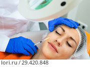 Купить «Woman doctor making beauty injection to young female client», фото № 29420848, снято 20 марта 2019 г. (c) Яков Филимонов / Фотобанк Лори