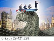 Купить «Businessman leading his team through wave of dollars», фото № 29421228, снято 18 февраля 2019 г. (c) Elnur / Фотобанк Лори