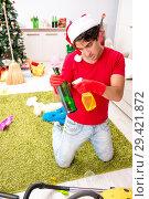 Купить «Man cleaning his apartment after christmas party», фото № 29421872, снято 17 июля 2018 г. (c) Elnur / Фотобанк Лори