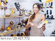 Купить «Woman holding desired shoe», фото № 29427772, снято 15 декабря 2018 г. (c) Яков Филимонов / Фотобанк Лори