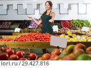 Купить «Young female seller wearing apron», фото № 29427816, снято 18 июля 2019 г. (c) Яков Филимонов / Фотобанк Лори