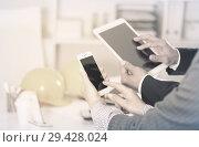 Купить «Businesspeople using devices», фото № 29428024, снято 20 апреля 2017 г. (c) Яков Филимонов / Фотобанк Лори