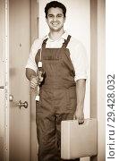 Купить «handyman at house entrance», фото № 29428032, снято 25 мая 2019 г. (c) Яков Филимонов / Фотобанк Лори