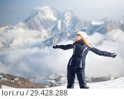 Купить «woman in winter sportswear stay on mountainside», фото № 29428288, снято 18 марта 2018 г. (c) katalinks / Фотобанк Лори